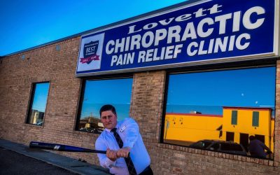 Dr Ky the Bambino outside Lovett Chiropractic playing Baseball